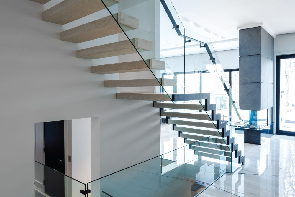 zig-zag and cantilevered stair / glass side mount handrail / rectangular painted aluminum handrails