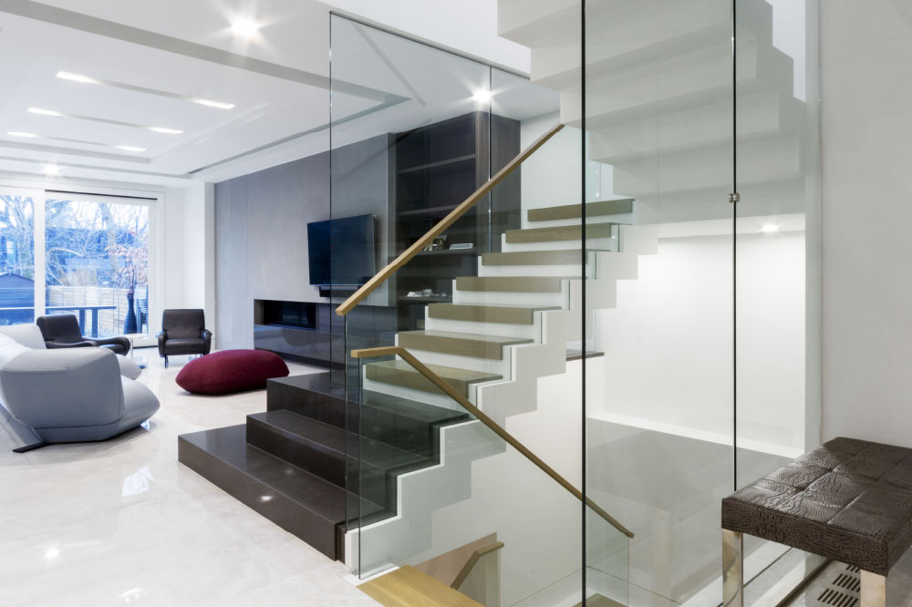 zig-zag stair / floor to ceiling glass / glass top mount handrails / rectangular wood handrails